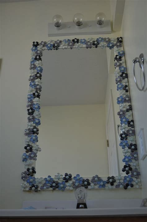decorate bathroom mirror glass gems with pearl marble centers to dress up a
