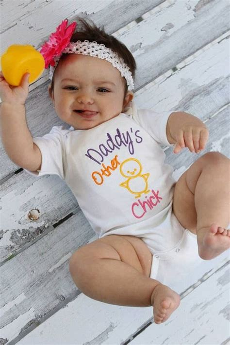 baby clothes embroidered with s other