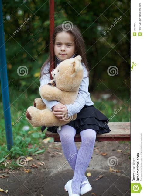 girl sitting   swing royalty  stock