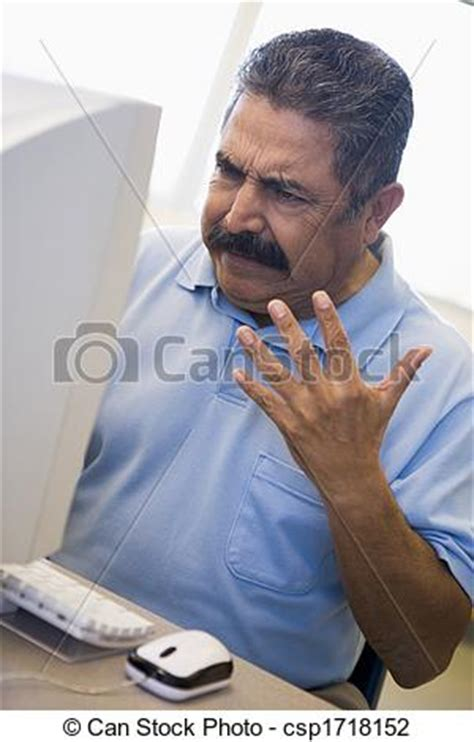 stock photo of man at computer looking at monitor