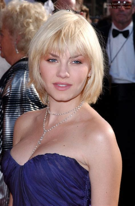 medium length hair tapered elisha cuthbert hairstyle that covers the neckline and
