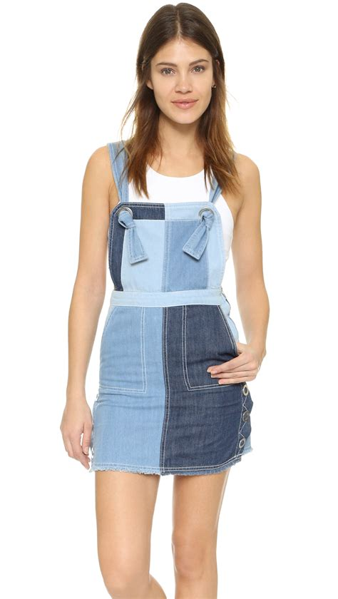 sjyp denim overall dress in blue lyst