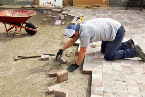 how to lay pavers on a driveway or patio reliable remodeler