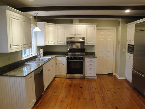 Soft White Kitchen Cabinets Soft White Cabinets With Rub Through Traditional