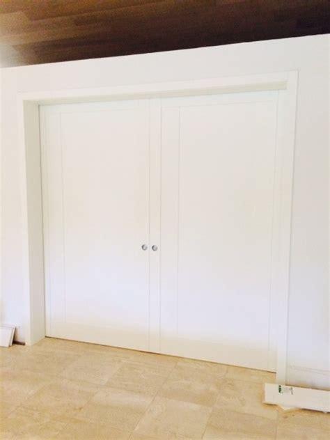 modern pocket door in matte white finish