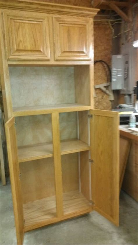 Pantry Cabinet With Microwave Shelf by Custom Pantry And Microwave Cabinet Our Work