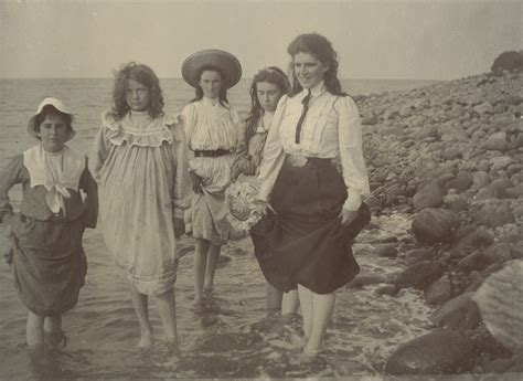 photographs  girls paddling   beach  woman