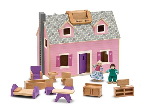 assembled doll houses amazon com melissa doug fold and go wooden dollhouse with 2 dolls and wooden
