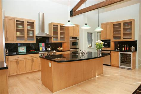 light maple kitchen cabinets dark granite countertops with light cabinets