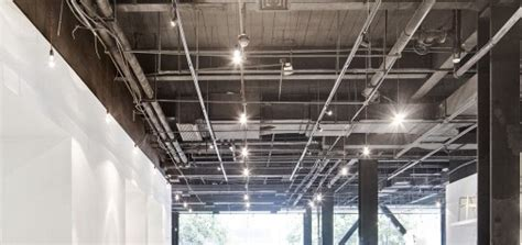 exposed ceiling showing lighting grid and ductwork image
