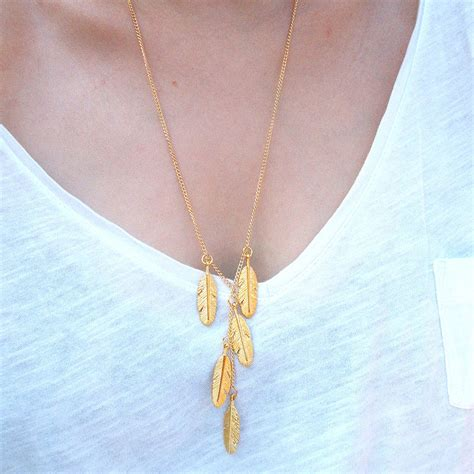 gold feather necklace by in a teacup