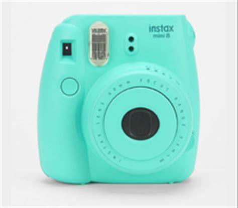 teal fuji polaroid camera on the hunt