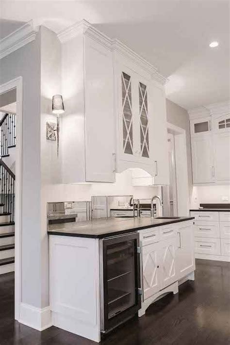 white kitchen cabinets with eclipse mullion k i t c h butler s pantry off kitchen boasts glass front x mullion