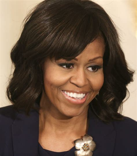 what is with michelle obama hair style michelle obama medium wavy cut with bangs michelle obama