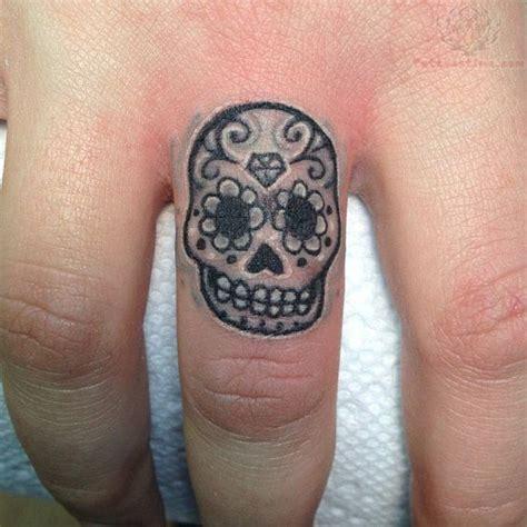 sugar skull finger tattoo best 25 skull finger tattoos ideas on small