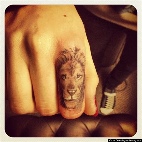 lion finger tattoo tumblr cara delevingne debuts new lion tattoo on her finger