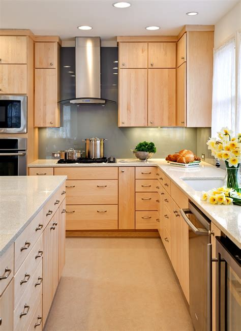 light brown wooden maple kitchen cabinets with storage and drawers combined with white counter