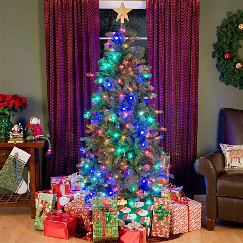 pre lit multi color led slim christmas tree 6 5 ft river slim multi colored led pre lit tree at hayneedle