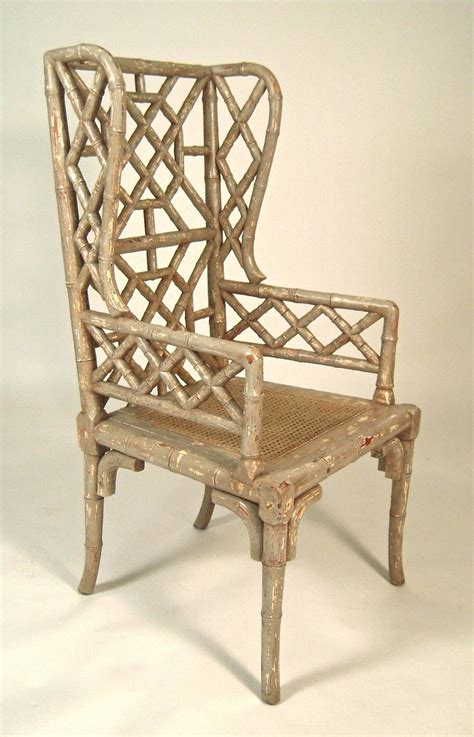 chinoiserie chic bamboo wing back chairs pair of chinoiserie faux bamboo wing chairs at 1stdibs