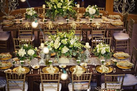 beautiful table settings green and brown hundreds of italian string lights hung above 10foot wooden