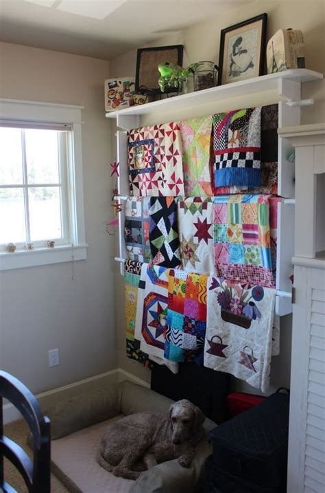 hanging quilts r creates storage texture for bedroom