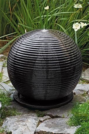 black ribbed resin sphere water feature landscape ideas