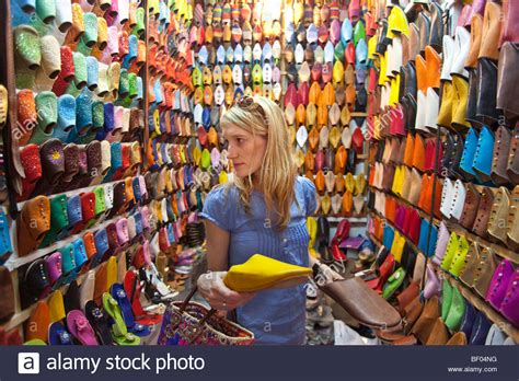 Sepatu Medina a western tourist buying shoes at marrakesh souk
