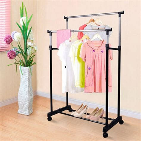 Racks For Hanging Clothes by Adjustable Portable Clothes Coat Hanging Rail Stand On