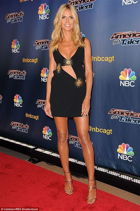 48 year old fashion heidi klum shows cleavage on america s got talent red
