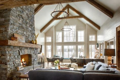 stacked stone fireplace  vaulted ceiling  exposed
