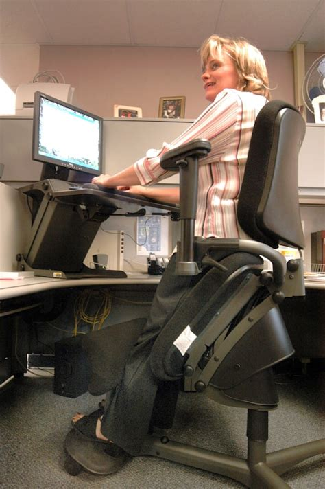 ergonomic chair desk system helps civilian stand  work  air force article display