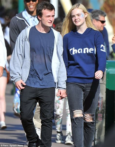 Elle Fanning poses at Disneyland's Sleeping Beauty Castle   Daily Mail Online
