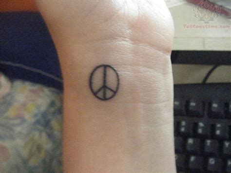 peace tattoo 36 attractive peace wrist tattoos