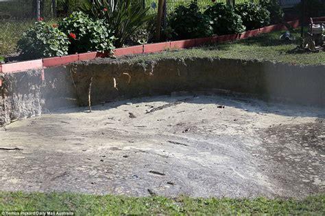 backyard sinkhole ipswich sinkhole appears in elderly couple s backyard