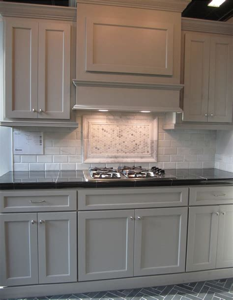 Grey Kitchen Cabinets With Black Countertops by Gray Cabinets Black Counters Slate Herringbone Floor