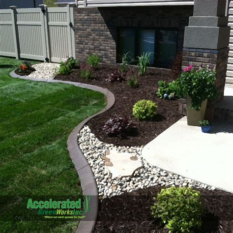 mulch bed ideas river rock and flagstone step stone allow access through