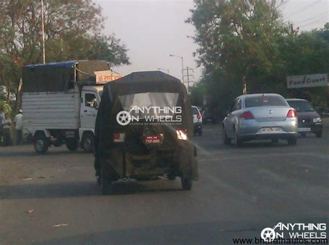 bajaj new 4 wheeler spied bajaj re60 four wheeler with heavy camouflage in pune