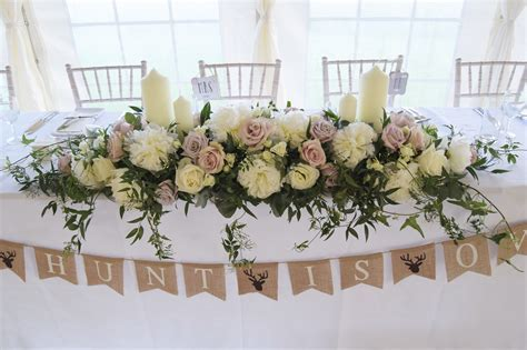 Long and low top table arrangement.   Flowers in 2019