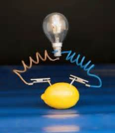 how to a lemon battery light a light bulb check out the crazily fascinating lemon battery experiment