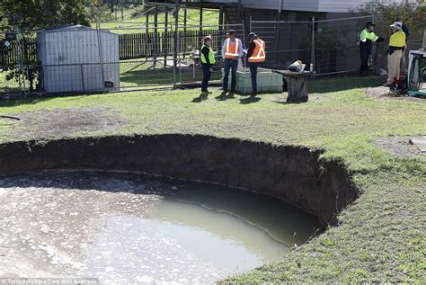 sinkhole in backyard ipswich sinkhole appears in elderly couple s backyard