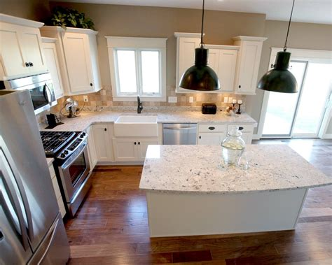 l shaped kitchen with island l shaped kitchen layout with an arched overhang on the island photo by applestone homes
