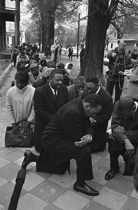 photo of a history photo of martin luther king kr kneeling