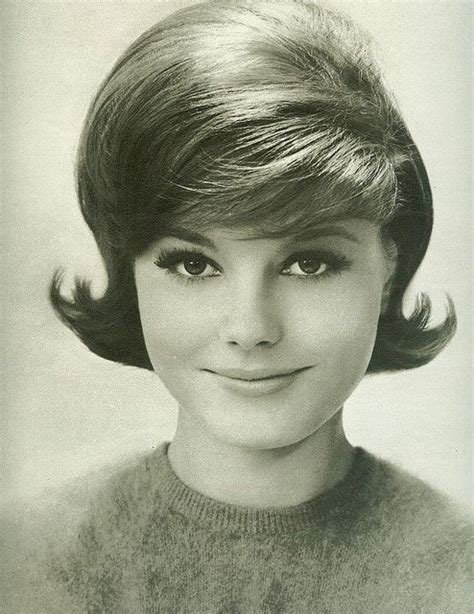 a lot of hair on woman this is the classic 1960 s hairstyle for women they still