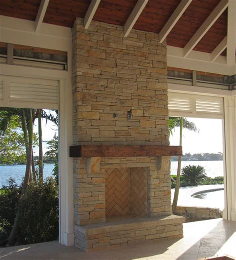 outdoor fireplace mantels outdoor fireplace limestone and wood mantel craftsman