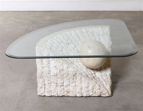 triangular marble and travertine coffee table with beveled