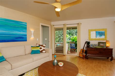 cool ceiling fans living room tropical with beige curtains