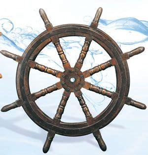 antique ship wheel nautical down by the sea