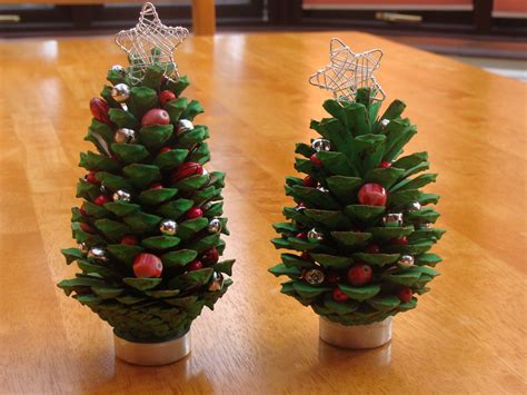 a little christmas tree craft project with fir cones