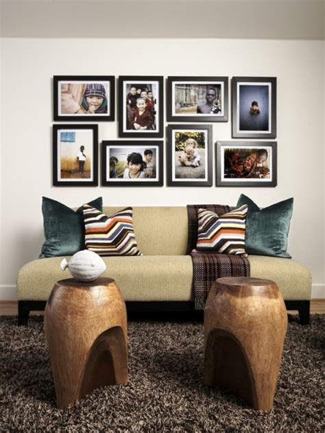 arranging pictures over sofa how to arrange a photo wall tips and creative ideas