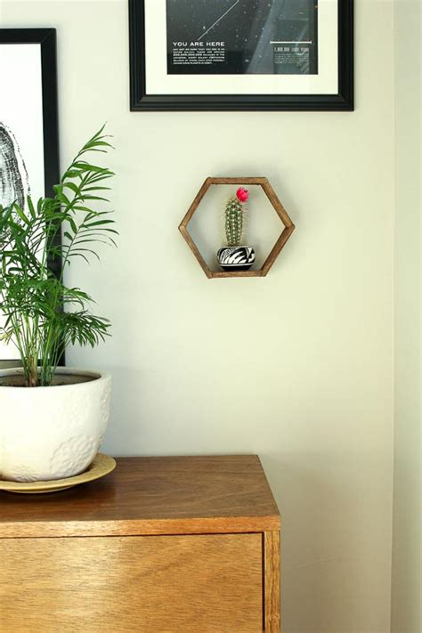 how to stick pictures on wall make a diy hexagon shelf with popsicle sticks huffpost